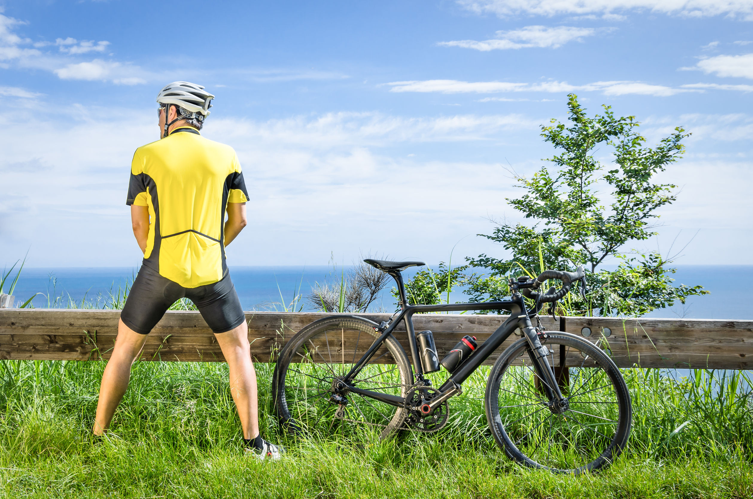 man and bicycle on cliffside taking the piss for better health urine tests physical wellbeing