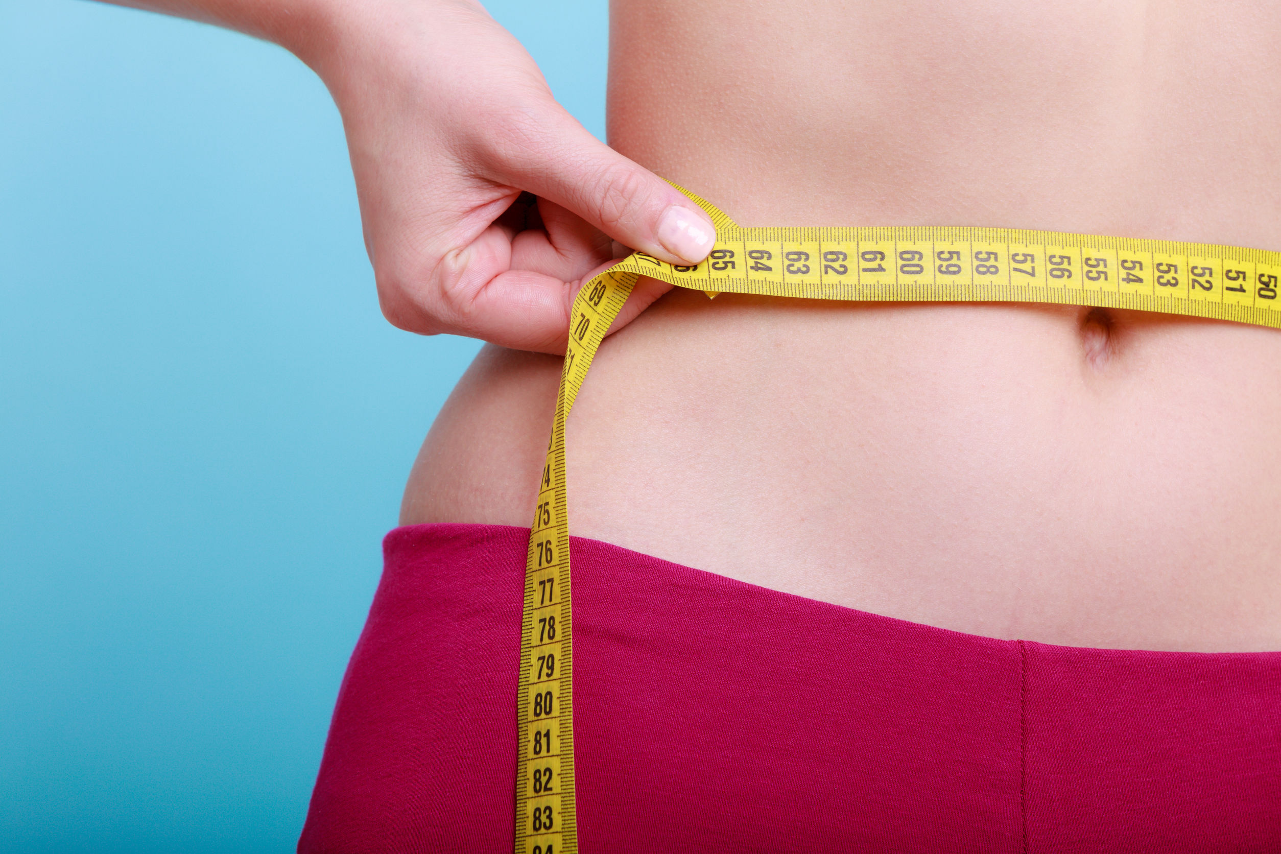 measuring tape on waist weight loss program without strict diet and exercise life changing program