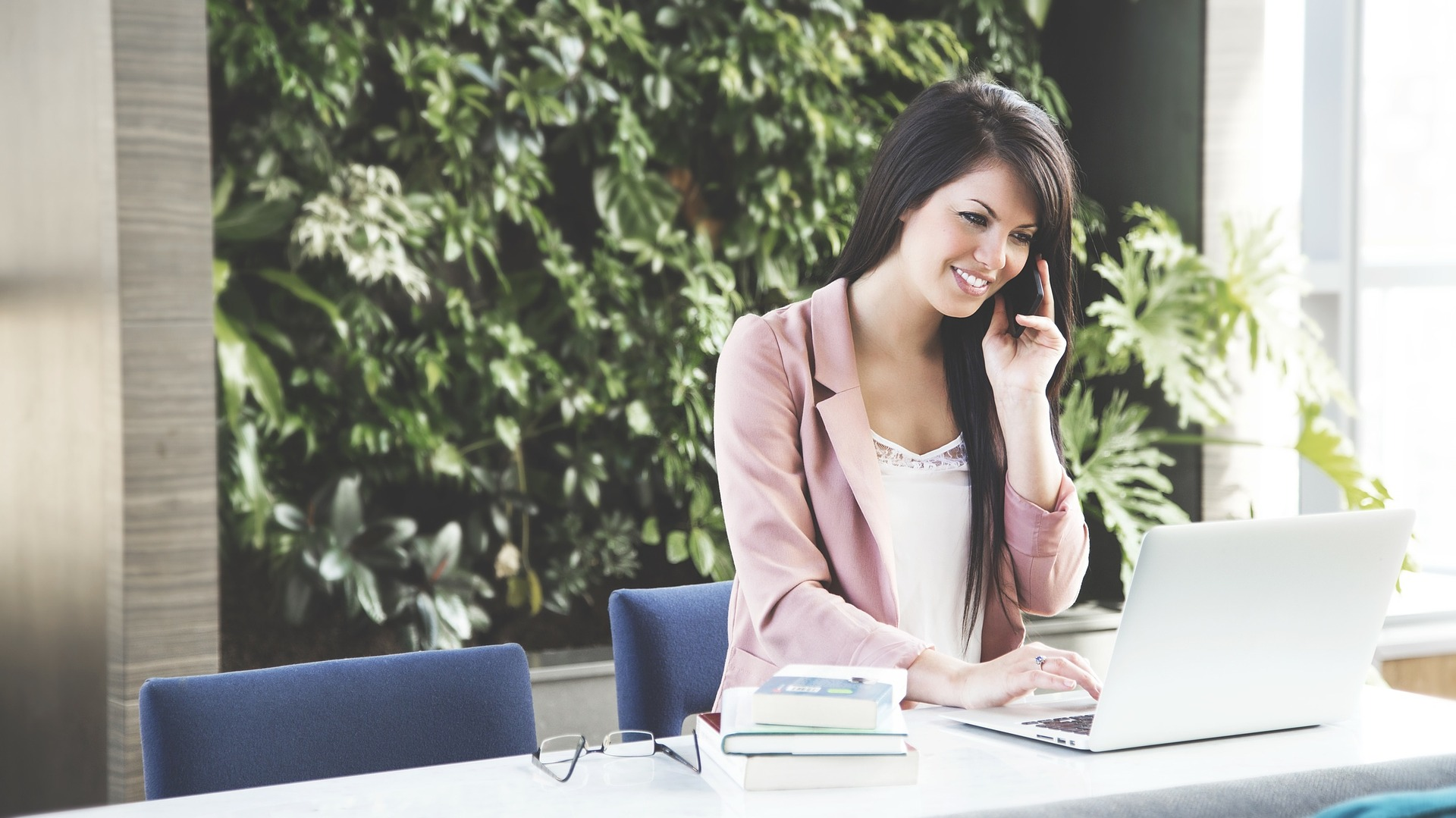 office worker women talking on phone eliminate job titles improve business culture