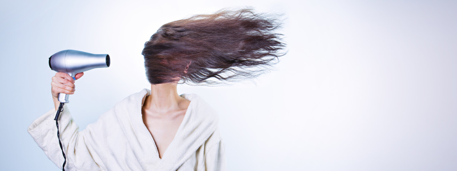 girls hair blowing in the wind self care increase productivity and prevent burnout