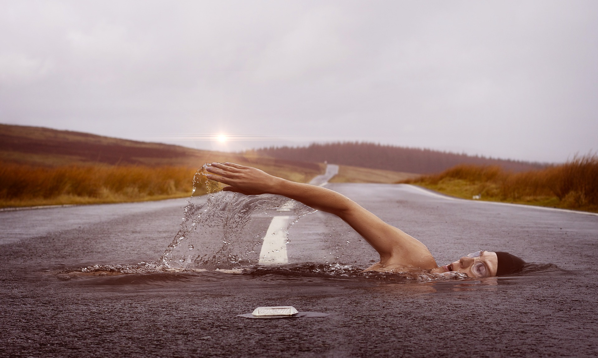 male swimming on pool middle of street running or swimming which is better for you
