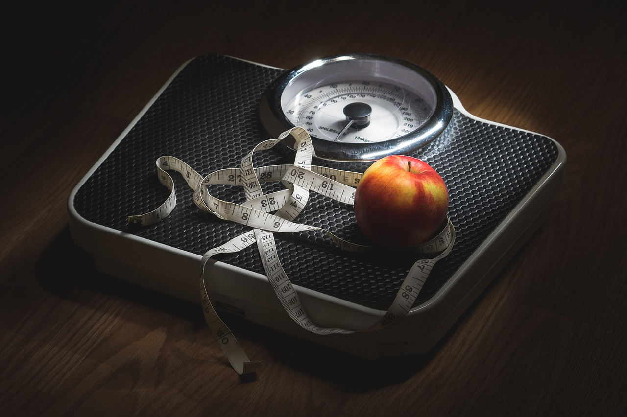 apples weight scale measuring tape obesity crisis in australia epidemic getting worse